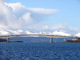 The Skye Bridge with snow covered Cuillin Hills in the background (© OLU)